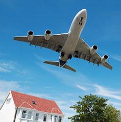 plane-flys-over-house-with-garage-door