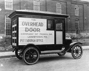 historical-photo-of-overhead-garage-door-repair-truck-in-1920s