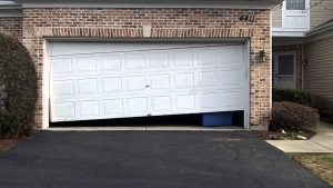 Broken Door - Broken Springs - Clarks Garage Door & Gate Repair
